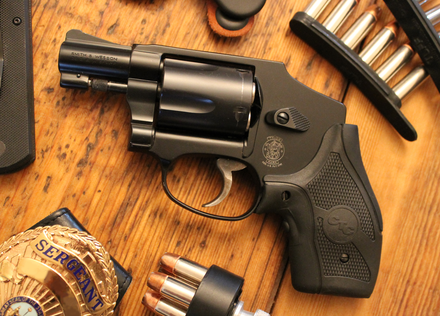 Smith & Wesson Centennial Airweight with badge