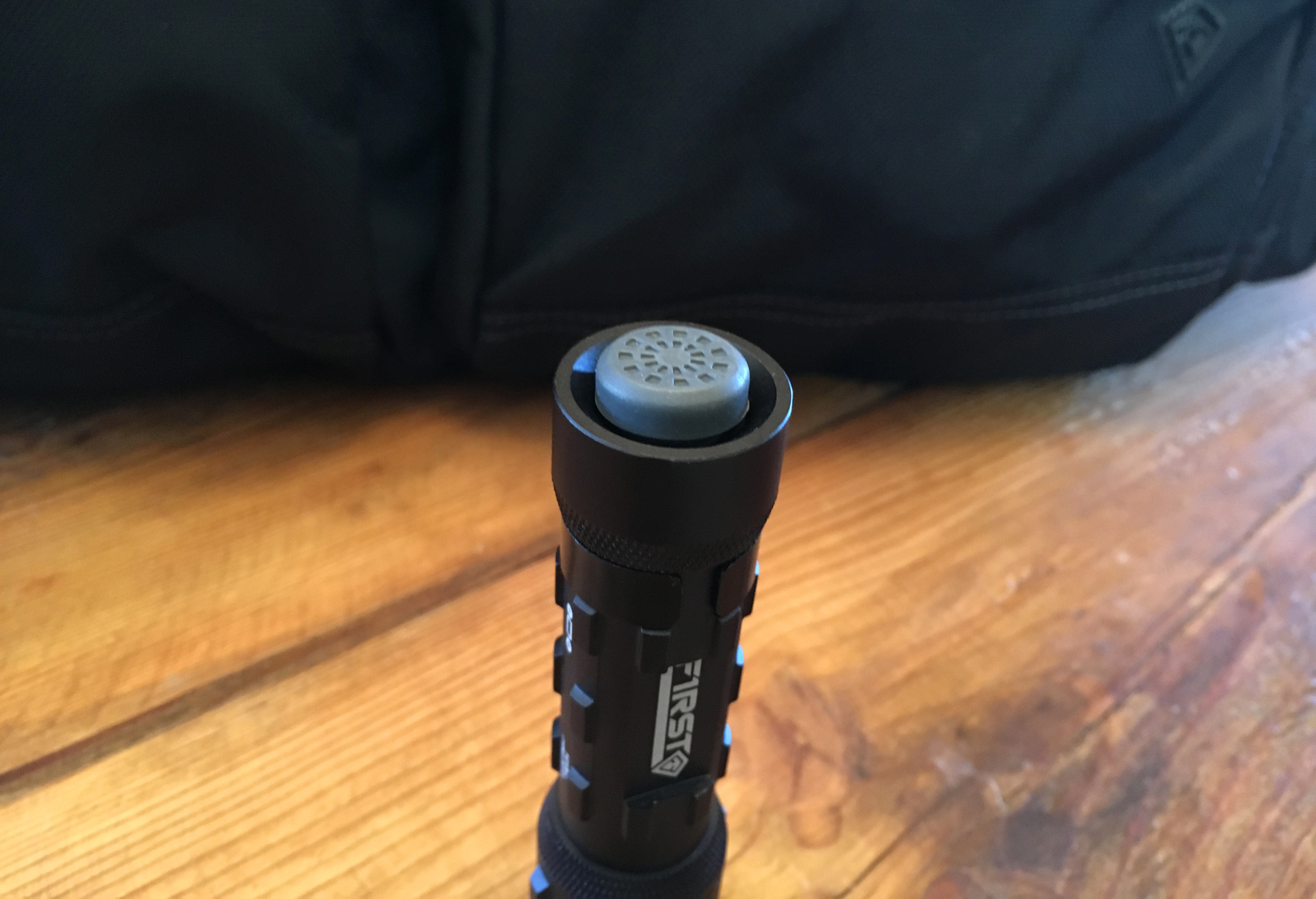 First Tactical Small Flashlight button